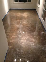 concrete floor refinishing 100 solid epoxy application before