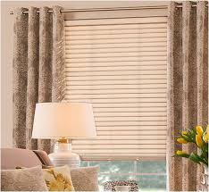 Blinds Shutters And More Graber Wood Blinds Combined With A Print Grommet Curtain On A