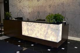 Reception Desk With Transaction Counter Walnut Reception Desk With Lighted 3form Panel And Quartz