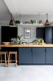 blue kitchen cabinets with wood countertops 75 beautiful kitchen with blue cabinets and wood countertops
