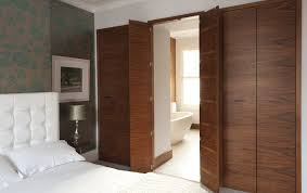 in suite designs wardrobes with secret door through to en suite bathroom home