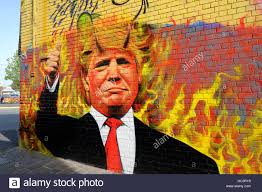 trump mural wall painted stock photos trump mural wall painted donald trump with devils horns graffiti painted onto a wall in melbourne australia