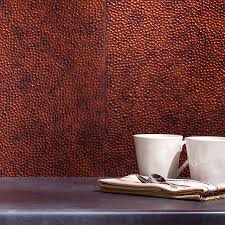 decorating interesting fasade backsplash for modern kitchen fasade backsplash hammered in moonstone copper with dark countertop and double coffee cups for kitchen decoration