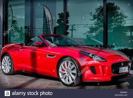 sports cars side view full length side view of a red jaguar f type british convertible
