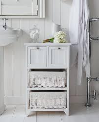 smart pine and wicker basket storage from our truro range bathroom