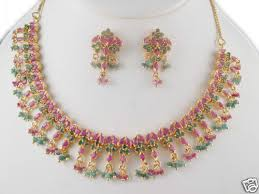 emerald ruby necklace images Beads hanging ruby emerald necklace with earrings gleam jewels jpg