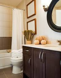 bathroom affordable renovations ideas for small elegant bathroom decorations dark finished vanity white top curtains rounded black framed mirror