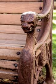 cast iron bench with lion head arms for sale at 1stdibs
