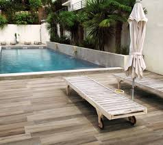 outdoor pool patio with porcelain tile floors contemporary