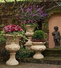 Tuscan Garden Decor Urn With Boxwood And Impatiens At Front Door Of House My Garden