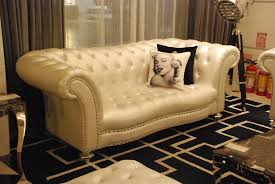 Black Leather Sofa With Cushions Decoration Modern Living Room Interior With Cream Wall And Glass