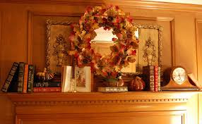 decorate a fireplace mantel for fall or autumn with books