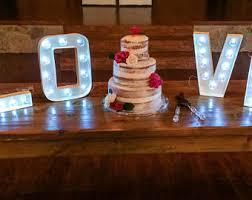 custom made cardboard light up marquee letter cake topper