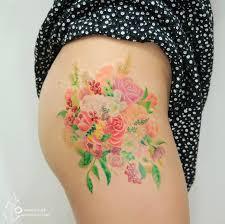 colorful flower tattoos that look like watercolor paintings