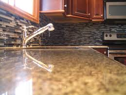decorating quartz countertop with brizo faucets and glass tile