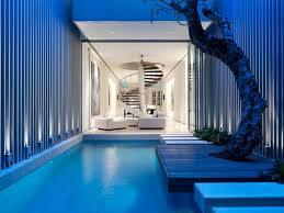 outdoor and patio pool house designs with brightly blue wall