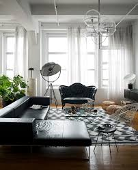 apartment industrial living room with black mini sofa with daybed