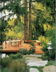deck over pond boulder steps towering firs japanese y