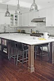 Kitchen With Wooden Island Table Oversized Kitchen Islands Are - Kitchen table island