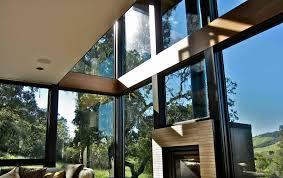 kk residence fireplace against casement windows marvin photo