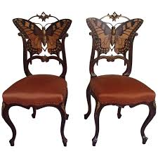 pair of early art nouveau butterfly chairs inlays and brass