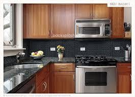 kitchen backsplash ideas for black granite countertops black granite glass tile mixed backsplash black backsplash