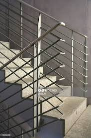 set of concrete stairs with metal bannister stock photo getty images