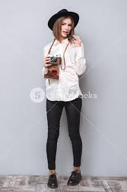 hipster girl full length portrait of a young hipster girl in hat standing and