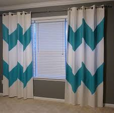 diy painted chevron curtains and orange accents u2022 the mix