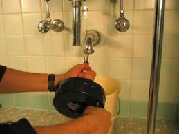 Using A Hand Held Sink Auger To Unclog A Sink - Kitchen sink auger