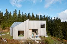 home architecture mork ulnes architects completes timber clad house in a forest
