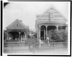 houses with porches file african american boy seated on porch of house another
