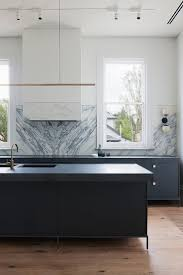 dramatic kitchen range hoods that completely steal the show