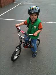 4 yr boy graduates from balance bike to pedal bike with barely