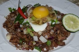 cuisine by region food aficionado pork sisig sour and spicy chopped pork
