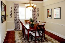 dining room with wooden dining chairs and table also decorated