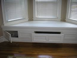 bay window storage bench below seat storage drawers and cupboards