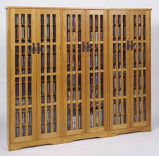 dvd cabinets with glass doors triple wide dvd cd cabinet with tempered glass door panels
