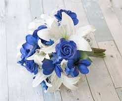 white blue roses white lilies with blue roses and plumerias touch silk
