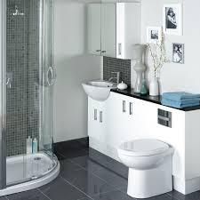 white bathroom vanity and white latrine on black tile floor of