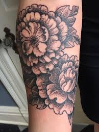stippling dotwork blackwork style peony flower forearm tattoo
