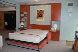 furniture brown wooden murphy bed with brown couch having white