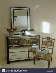 Mirror Chest Of Drawers Large Mirror Above Mirrored Chest Of Drawers In Modern Bedroom