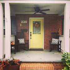home front door helloyellow bright yellow front door with red brick exterior