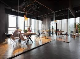 concrete interior design wood glass and concrete play an important role in this office