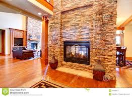 luxury house interior stone wall with fireplace stock photo