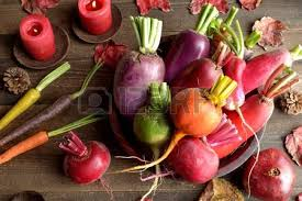 Fall Root Vegetables - colorful root vegetables with red fall leaves stock photo picture