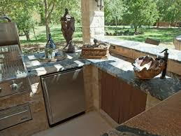 modern outdoor kitchen ideas grey stone bricking walls white pine