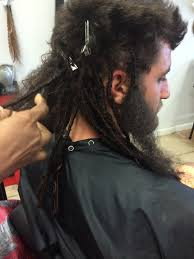 installing extension dreads in short hair in process of installing dread extensions