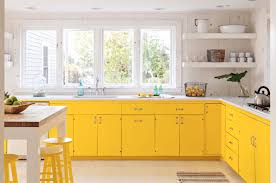 kitchen cabinet pictures yellow kitchen cabinet design with windows and dining table 2222